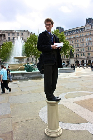 man on pedestal